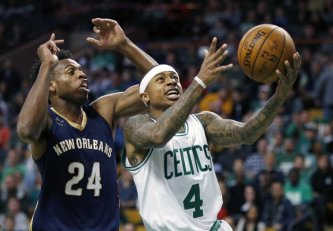 Boston Celtics' Isaiah Thomas (4) goes up to shoot in front of New Orleans Pelicans' Buddy Hield (24) during the first quarter of an NBA basketball game in Boston, Saturday, Jan. 7, 2017. (AP Photo/Michael Dwyer)